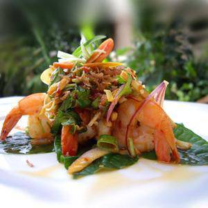 Prawns salad, topped with crispy vegetables and lime dressing