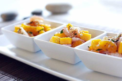 Tropical fruit salad with baby prawns and toasted coconut