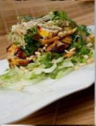 Marinated curry chicken salad with mushroom tips and pine nuts