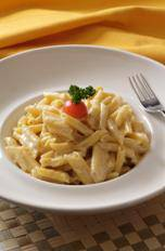 Penne pasta with creamy cheese sauce