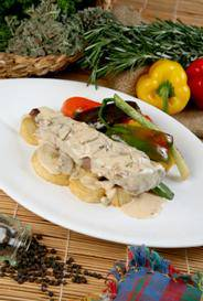 Veal tenderloin with mushroom sauce, sauté potatoes and grilled vegetables